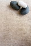 Pebbles and linen, zen textures background Stock Photography
