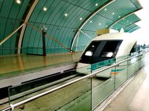 Shanghai MagLev train approaching station. A photograph showing the high speed ultra modern magnetic levitation train at the Shanghai Pudong station, approaching royalty free stock images