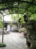 Ancient traditional style garden in Suzhou, China. A photograph showing a pretty corner inside an old famous landmark garden in the city of Suzhou, China. With royalty free stock photos