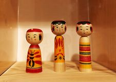 Traditional Japanese girl dolls. A photograph showing some cute and adorable little toys girls doll carved out of wood and painted in bright cheerful colours stock photography