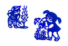 Traditional china paper cut children art. A photograph showing 2 traditional style chinese paper cuttings, depicting children in outdoors garden activities of stock photos