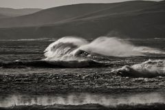 Black and white image of power nature forces and ocean waves royalty free stock photography