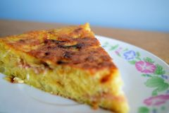 Sliced french omelette. Photograph of a slice of a french omellete royalty free stock photos
