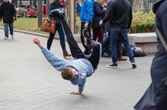 Photograph of some guys doing break dance in the streets of London, United Kingdom. November 2013 royalty free stock photography