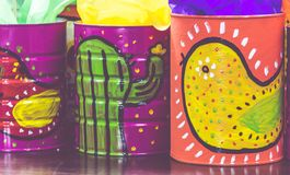 Mexican traditional style painted cans. Photograph of some metal cans with mexican symbols Royalty Free Stock Photos