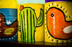 Mexican traditional style painted cans. Photograph of some metal cans with mexican symbols Royalty Free Stock Images