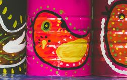 Mexican traditional style painted cans. Photograph of some metal cans with mexican symbols Stock Photos
