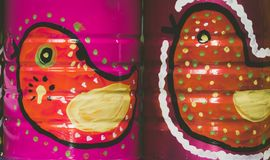 Mexican traditional style painted cans. Photograph of some metal cans with mexican symbols Royalty Free Stock Image