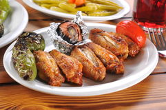 Photograph of some tasty barbecue chicken wings with salad. Black bright callow chicken colorful Xcoward cutlet stock images