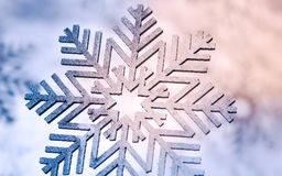 Wood painted snowflakes symbols. Photograph of some wood painted snowflakes symbols Stock Images