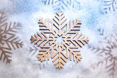 Wood painted snowflakes symbols. Photograph of some wood painted snowflakes symbols Royalty Free Stock Photos