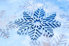 Wood painted snowflakes symbols. Photograph of some wood painted snowflakes symbols Stock Photography