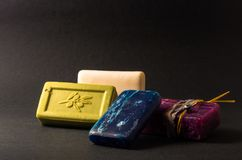 Stack of colorful handmade soaps. Photograph of a stack of handmade soaps on a smooth grey background Stock Photography