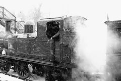 Steam train in snow B Stock Photo