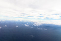 Photograph taken above the clouds over the Ocean. Royalty Free Stock Image