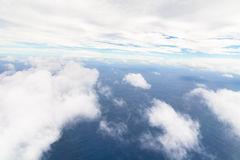 Photograph taken above the clouds over the Ocean. Stock Photos