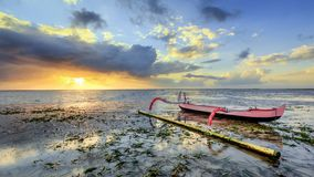 Fishing boat is parked on the shore in Bali, Indonesia stock photo