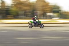 Green motorcycle at a roundabout stock photos