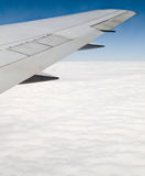 Airplane Wing Above Clouds Royalty Free Stock Photography