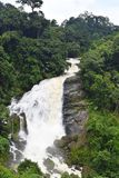 Valara Waterfall in Kerala, India - Ledge Waterfall in Green Forest. This is a photograph of Valara waterfall in Kerala, India... The waterfall is a large ledge Stock Photos