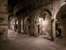 Night walk in Santiago de Compostela. Photograph of visitor walking in streets of Santiago de Compostela, Spain stock photo