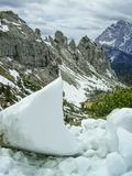 Snow remnants in the Dolomites, Italy in spring royalty free stock images