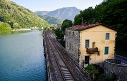 Train tracks along the river royalty free stock photo