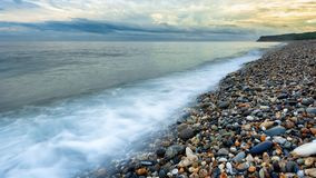This photograph was taken in Hualien, Taiwan. It is a famous pebble beach. One can see heaps of pebbles of different colors,. Shapes and sizes. The clouds and stock photography