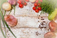 On a wooden bleached tabletop lies a set of vegetables for cooking. On a photograph on a wooden table painted in white paint lie a set of vegetables for cooking royalty free stock photos