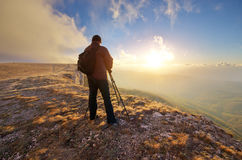 Photograph work in mountain. Royalty Free Stock Images