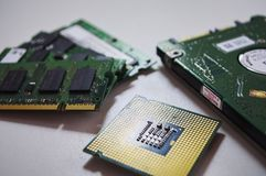 Desktop Computer Microprocessor, Laptop Memory RAM and Notebook Hard drive disk on white background royalty free stock photo