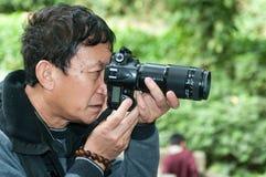 Photographe aîné Images stock
