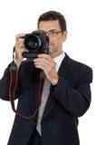 Photographe adulte d'homme avec le dslr d'appareil photo numérique d'isolement Photos libres de droits