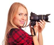 Photographe amateur de charme tenant un appareil-photo professionnel - OIN Images stock