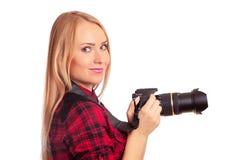 Photographe attirante de femme au travail avec DSLR Image stock