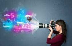 Photographe avec l'appareil-photo et imaginaire abstrait photo stock