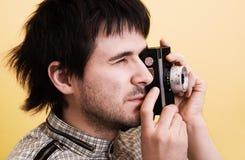 Photographe avec le rétro appareil-photo photo stock