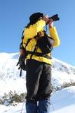 Photographe dans la montagne photos stock