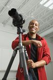 Photographe dans le studio. Image stock