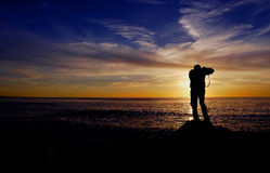 Photographe de coucher du soleil Image stock