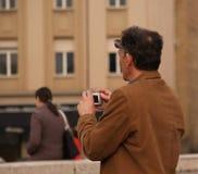 Photographe de Dreamstime dans l'action Image stock