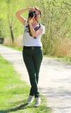 Photographe de femme dans la pose de photo Image stock