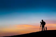 Photographe en silhouette Photos stock