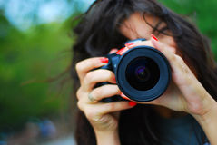 Photographe et un appareil-photo Photos stock