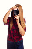 Photographe féminin attirant tenant un appareil-photo professionnel - I Photographie stock