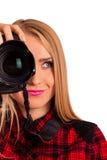 Photographe féminin attirant tenant un appareil-photo professionnel - I Photo libre de droits