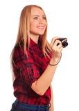 Photographe féminin de charme tenant un appareil-photo compact - d'isolement Image stock