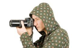 Photographe prenant une pousse avec un appareil photo numérique Images libres de droits