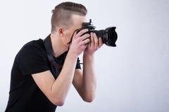 Photographe sur le fond d'isolement Photo stock