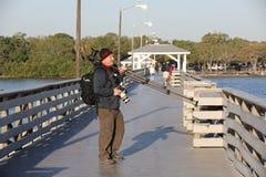 Photographe sur le pilier avec la vitesse d'appareil-photo Photographie stock libre de droits